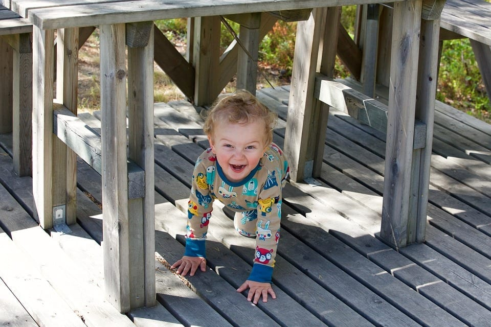 Child playing under table